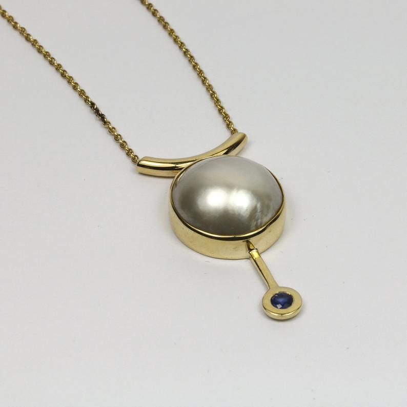 Glistening Pearl & Sapphire Pendant 24
